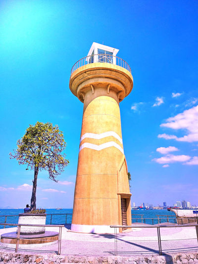Sun light and the blue sky The Blue Sky Under The Sun Architecture Blue Building Exterior Built Structure Cloud - Sky Day Guidance Large Sky Lighthouse Low Angle View Nature No People Outdoors Plant Protection Safety Security Shore Sky Sunlight Together Forever Tower Tree