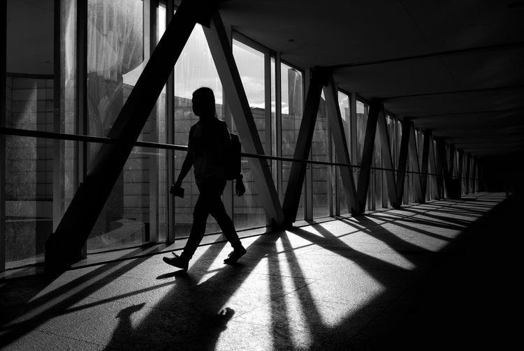 Silhouette man walking in corridor
