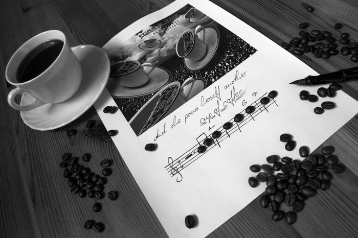 """One of my favourite songs... another cup of coffee :) I hope it really is in a minor... I don't have the absolute hearing but from """"singing"""" the refrain could be like this... I hope... 😁 Bnw_friday_eyeemchallenge Close-up Coffee Coffee - Drink Coffee Cup Day Handwriting  High Angle View Indoors  No People Studio Table Handwriting  EyeEm Best Shots Malephotographerofthemonth Cup Bnw_coffee"""