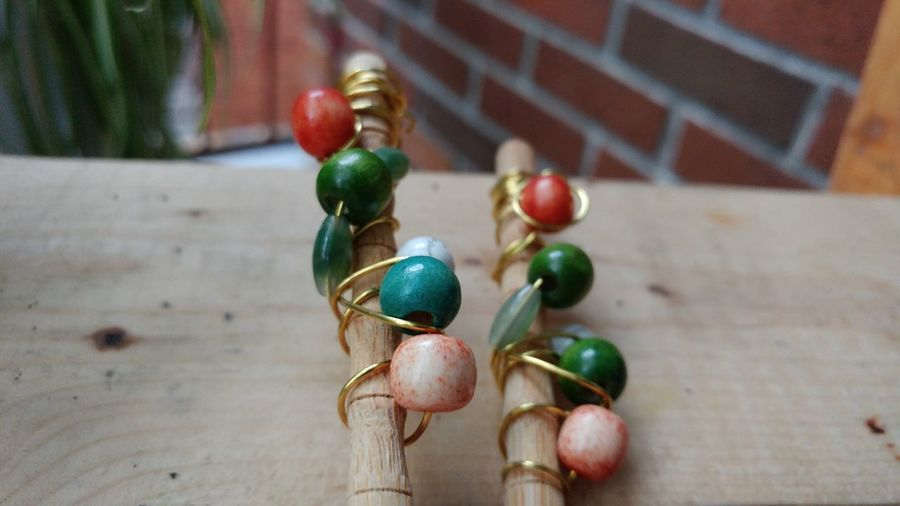 Close-up of colored beads on table