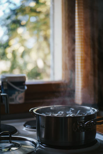 Close-up of potatoes boiling in saucepan on stove