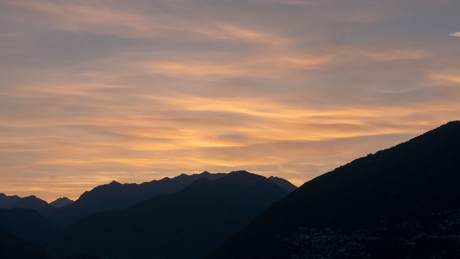 Swiss Alps, sunset Mountain Sky Sunset Scenics - Nature Beauty In Nature Cloud - Sky Tranquil Scene Tranquility Mountain Range Silhouette Nature Idyllic No People Non-urban Scene Environment Orange Color Landscape Outdoors Remote Majestic Mountain Peak
