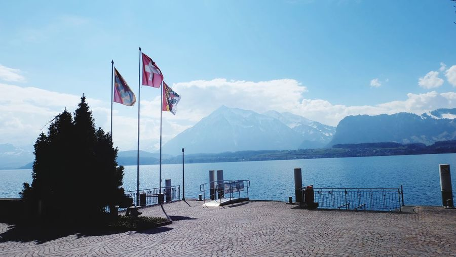 Port Thunersee Thun Lake Water Tree Sea Mountain Patriotism Blue Flag Politics And Government Wind Sand