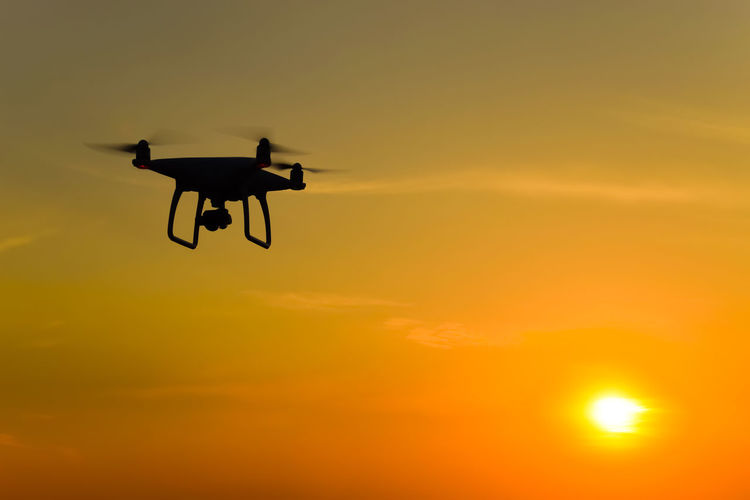 drone Drone  Dji Phantom 4 Dji Phantom Phantom 4 Silluette Sunset Sun Flying Sky Orange Color Air Vehicle Mid-air Transportation Silhouette Mode Of Transportation Airplane on the move No People Nature Low Angle View Beauty In Nature Drone  Outdoors Helicopter Motion Sunlight