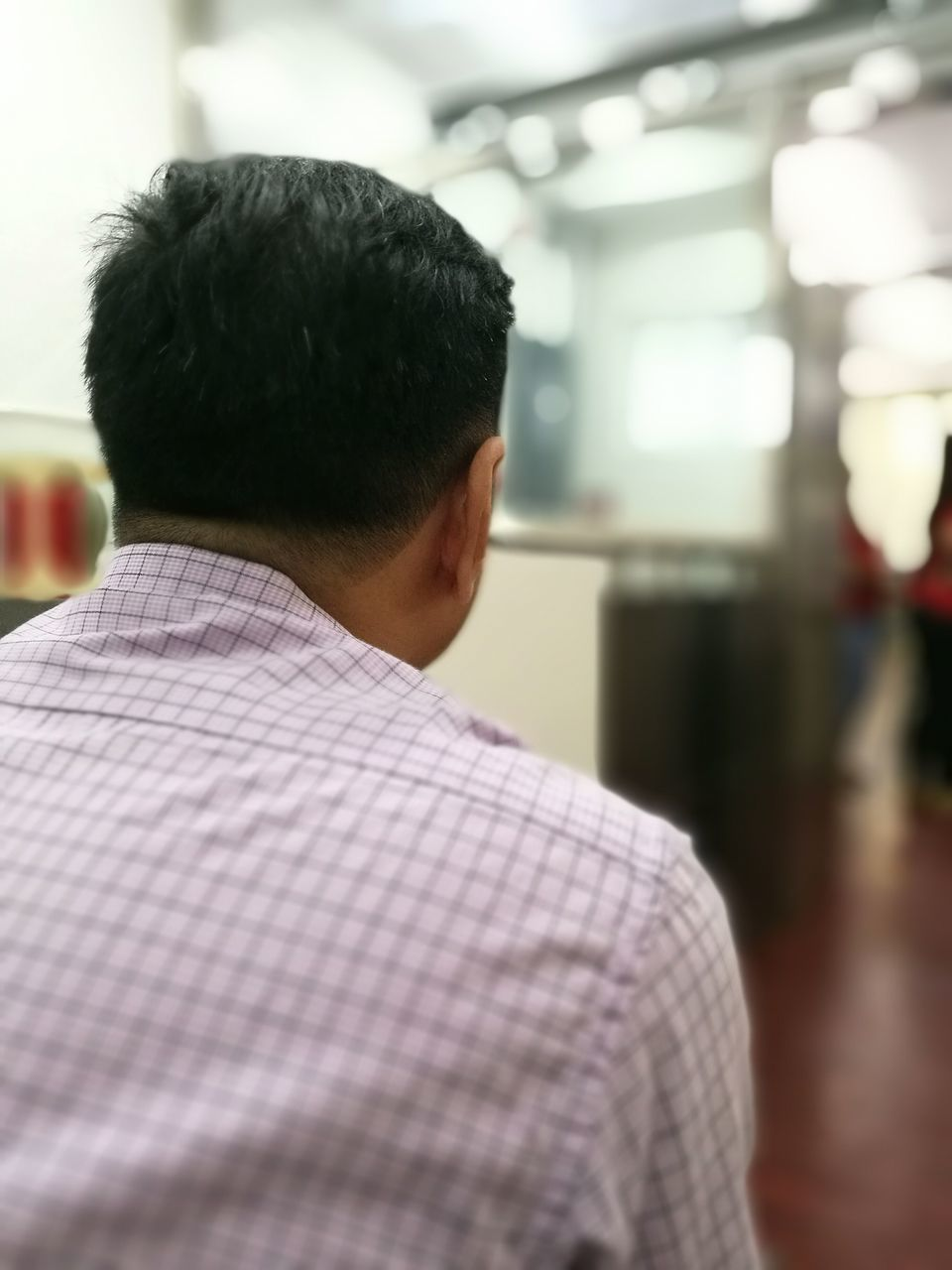 rear view, focus on foreground, real people, men, indoors, businessman, headshot, one person, business, close-up, day, one man only