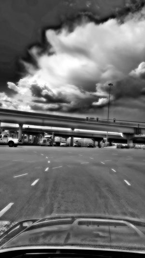 Driving Traffic Taken By M. Leith Mein Automoment Taken On Mobile Device No People City Expressive Sky Filtered HDR Black And White Street Photography In The Car Showcase June