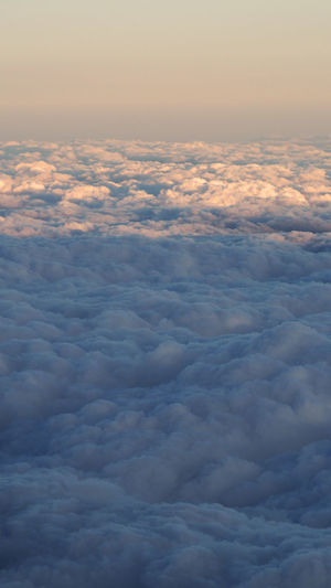 White clouds and blue sky with yellow warm sun light from airplane window. Backgrounds Beauty In Nature Cloud - Sky Clouds; Sky; View; Cloudscape; Sun; Cloud; Beautiful; Above; Airplane; Sunny; Background; Aerial; White; Horizon; Blue; Fluffy; Heaven; Over; Cloudy; Atmosphere; Window; Nature; Bright; Freedom; Eye; Weather; Sunlight; Air; Top; Flight; Light; Travel; Pla Cloudscape Day Dramatic Sky Nature No People Outdoors Scenics Sky Sky Only Tranquility