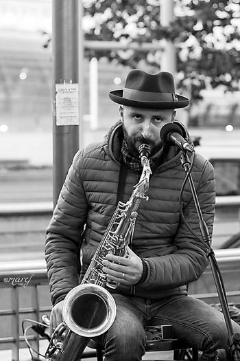 ...let the music play... Music Musician Playing Musical Instrument Saxophone Arts Culture And Entertainment Jazz Music Saxophonist Performance Plucking An Instrument People Canonphotography Canon_official EyeEm Gallery The Week Of Eyeem Turin Torino Blackandwhite Photography Musica Blackandwhite Music Photography  Musicians Streetmusic Streetphotography_bw Music