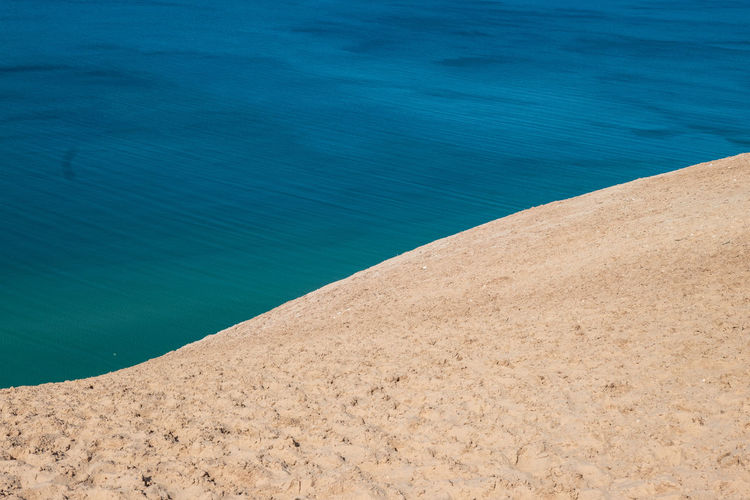 Sleeping Bear Sand Dunes Amazing View Lakeshore Lake Sleeping Bear National Lakeshore Sleeping Bear National Park Sleeping Bear Dunes National Lakeshore Sleeping Bear Dunes Lake Michigan Tranquil Scene Turquoise Colored Idyllic Sunlight Outdoors Scenics - Nature No People Sand High Angle View Nature Day Beauty In Nature Blue Tranquility Beach Land Water USA Roadtrip