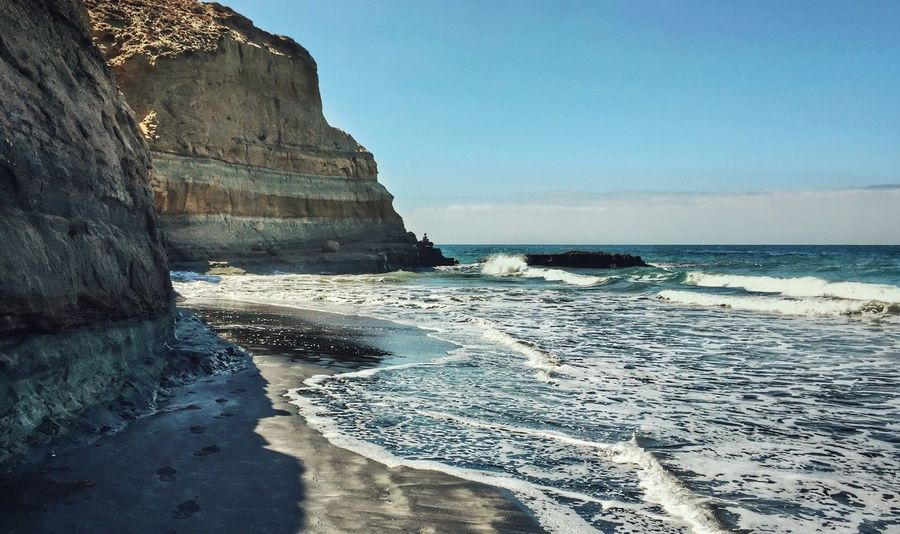 A Path to Self-Reflection. Sea San Diego Rock Formation Scenics Beauty In Nature Nature Water Beach California Sky Outdoors Wave Tranquil Scene Cliff Tranquility Sand Day Clear Sky Man Alone Thoughts Reflection Decisions Life Lifestyles