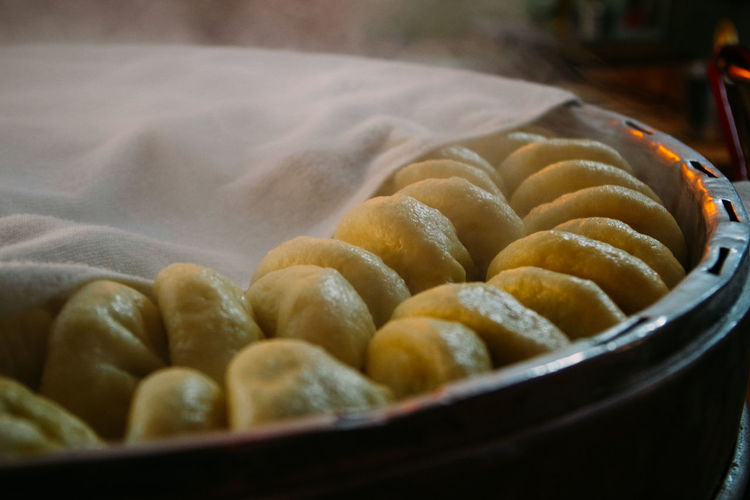 Close-up of chinese dumplings in wooden container