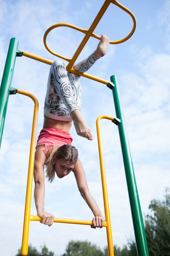 Acrobatic Apparatus Athletic Background Caucasian Cloudscape Down Exercises  Female Girl Gymnastic Hanging Outdoors Outside Park Sport Woman