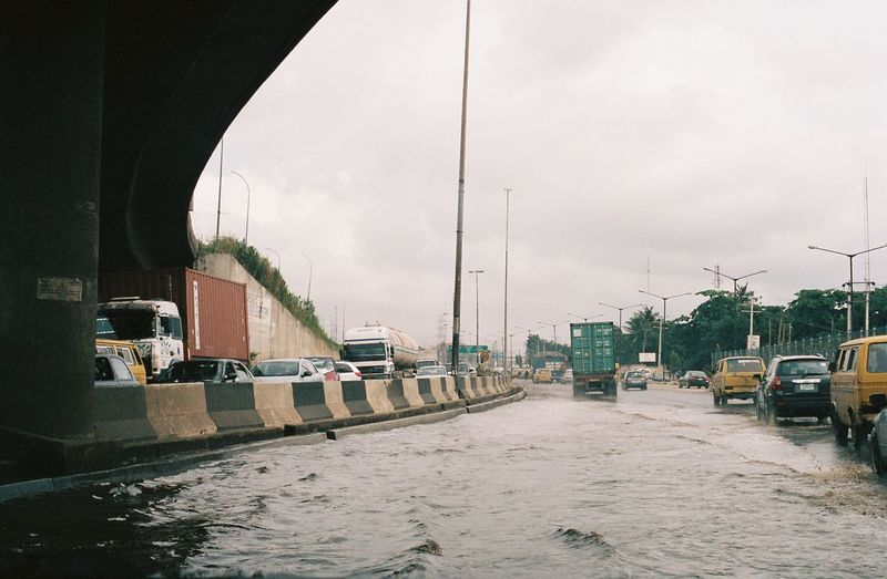 Bad road is a norm in Lagos. Transportation Mode Of Transportation Architecture Built Structure Sky City Building Exterior Car Motor Vehicle Day Land Vehicle Nature Street No People Water Bridge Travel Building Outdoors Canal Flood The Week on EyeEm 35mm Film