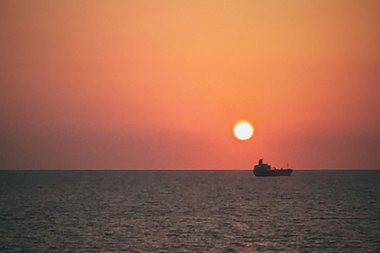 Sea Sunset Horizon Over Water Water Scenics Nature Tranquil Scene Sun Tranquility Nautical Vessel Transportation Beauty In Nature Sky Outdoors Silhouette Clear Sky No People Moon Sailing Offshore Platform
