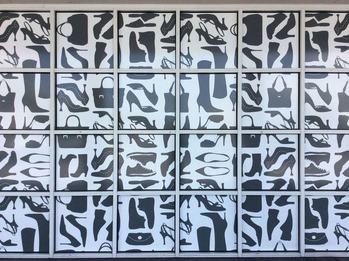 Houston Texas shop detail Shoe And Footwear Pattern black and white Glad Square Windows white metal window frames USA