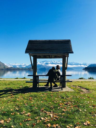 Timeless Akubukankiwi Water Nature Sky Real People Lifestyles Men Leisure Activity Day Sitting Grass Beauty In Nature Clear Sky Outdoors Women Beach Land People Plant Sea