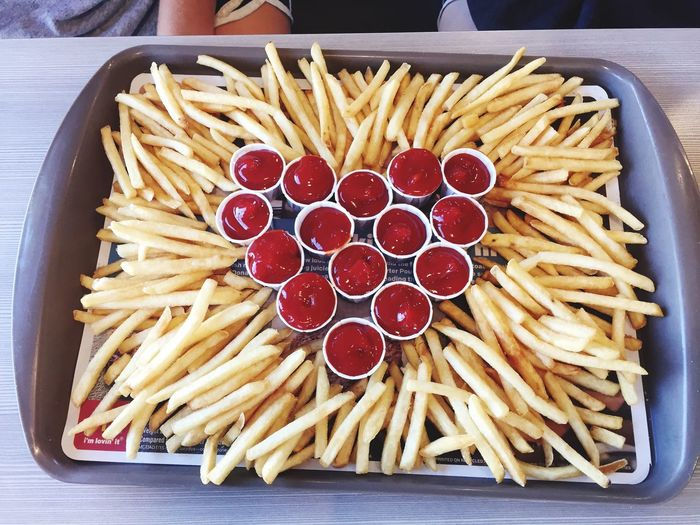High angle view of french fries with ketchup in tray on table