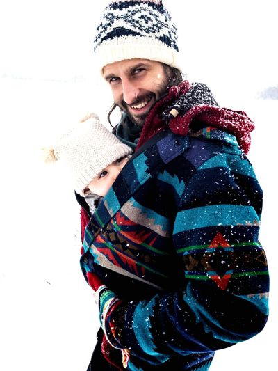 happy dad and baby in the snow Real People Alpine Happy People Winter Dad Hike Active Lifestyle  Snowstorm Snowfall Father Care Baby Baby Carriage Winter Clothing Cold Temperature Hat Snow Moments Of Happiness Warm Clothing Happiness Emotion Smiling Portrait Beard Positive Emotion