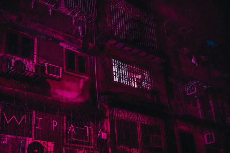These are all pictures from a series I call Mumbai Noir, where I walk around the city at night through to capture scenes & show the city through my artistic vision. The Creative - 2018 EyeEm Awards Architecture Backgrounds Building Built Structure Ceiling Communication Full Frame Illuminated Indoors  Lighting Equipment Low Angle View Night No People Pattern Pink Color Purple Red Text Wall - Building Feature Window HUAWEI Photo Award: After Dark