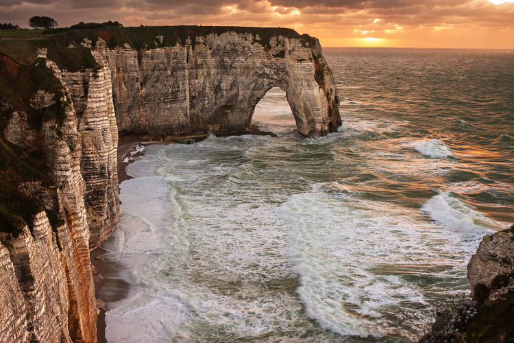 Natural Arch in Etretat, France étretat Etretat Cliffs Etretat Cliff France Sunset Storm Natural Arch Arch Waves Scenics - Nature Sea Ocean Beauty In Nature Nature Cliff Travel Destinations No People Outdoors Travel Water