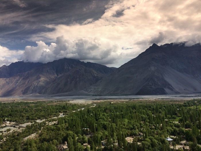 Mountain Scenics Tranquil Scene Non-urban Scene Landscape Sky Cloud - Sky Tranquility Plant Cloud Beauty In Nature Mountain Range Nature Majestic Countryside Solitude Growth Physical Geography Day Remote JammuandKashmir Hundur Ladakh India