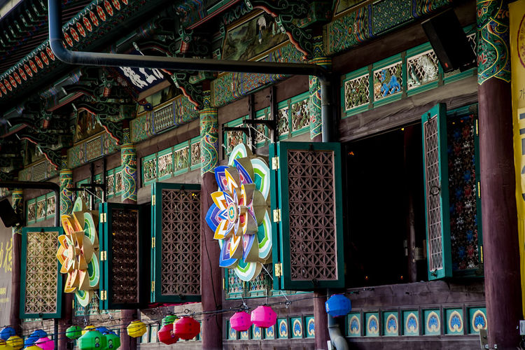Abundance Architecture Art Art And Craft Bongeunsa Buddhism Buddhist Temple Choice Creativity Culture Cultures Eaves Famous Place Human Representation Illuminated Large Group Of Objects Market Market Stall Multi Colored Ornate Religion Retail  Store Variation Window