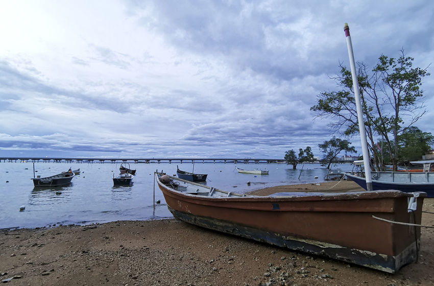 Pictures around the sea by boat at evening Nautical Vessel Water Transportation Moored Mode Of Transportation Sky Cloud - Sky Sea Beach Nature Land Tree Beauty In Nature Tranquility Scenics - Nature No People Day Plant Sand Outdoors Fishing Boat Rowboat Anchored