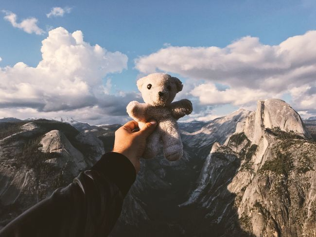"In 1991, my parents were on a road trip across the U.S. and brought me a white teddy bear from Yosemite National Park as a gift in a bag from the park. I don't have many young childhood memories but I remember this one perfectly. ""Iôzemite"" I've named it, like saying ""Yosemite"" in a wrong way in portuguese, because that's how I read it on the bag. Today, 25 years later, he came back home. 🌲🐻🌲 Wanderlust Original Experiences Road Trip Childhood Childhood Memories Teddy Bear Yosemite National Park Eyeemphoto Place Of Heart Let's Go. Together. The Traveler - 2018 EyeEm Awards Original Experiences Road Trip Childhood Childhood Memories Teddy Bear Yosemite National Park Eyeemphoto Place Of Heart Let's Go. Together. The Traveler - 2018 EyeEm Awards Human Hand Personal Perspective Holding Outdoors Leisure Activity Nature Mountain"