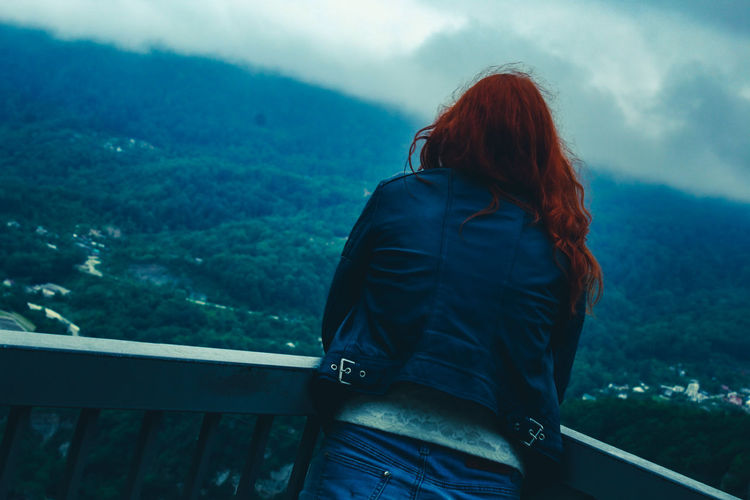 Rear view of woman looking at mountain