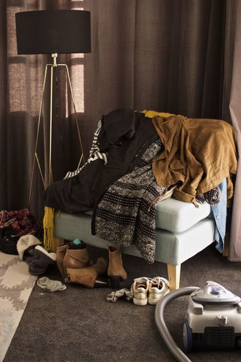 Clothes on sofa at home