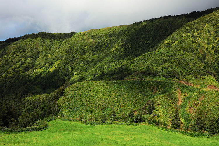 Scenic View Of Green Mountains At Azores