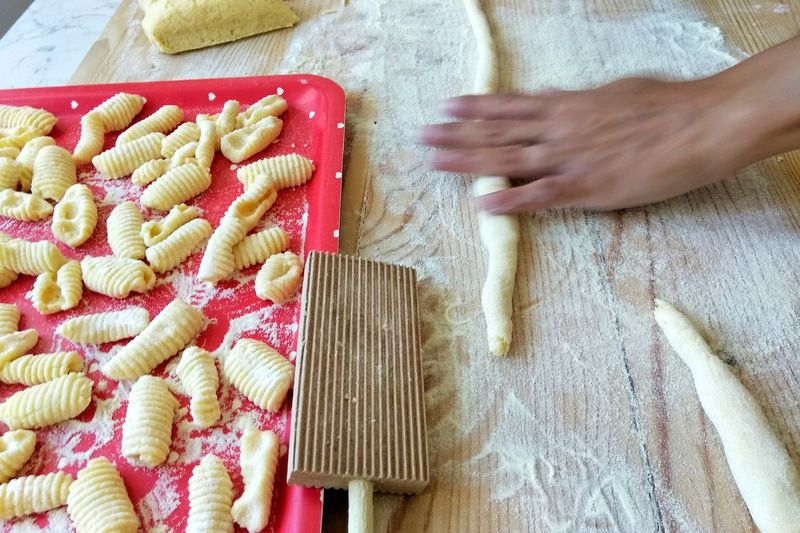 Indoors  High Angle View Raw Food Preparation  Food And Drink Human Hand People Italian Food Human Body Part One Person One Man Only Dough Homemade Adult Food Adults Only Only Men Freshness Day Close-up Homemade Pasta Pasta Home Made Gnocchihomemade Gnocchi Di Patate