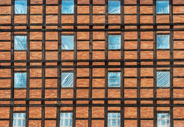 Prussian wall texture. wooden beams and bricks with windows in foil