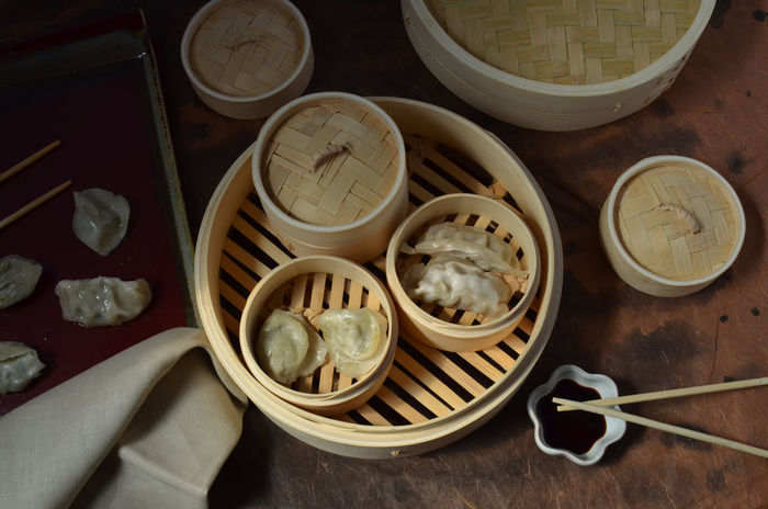 Dim Sum is eaten for breakfast in Hong Kong, China. In the USA, we most often eat pot stickers for lunch. Abundance Bamboo Chinese Food Chopstick Chopsticks Dim Sum Fresh Freshness Group Of Objects Indoors  Man Made Object Pot Stickers Ready-to-eat Steamer Table