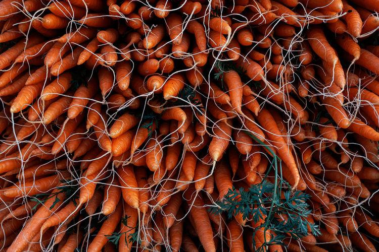Full frame shot of stacked carrots for sale