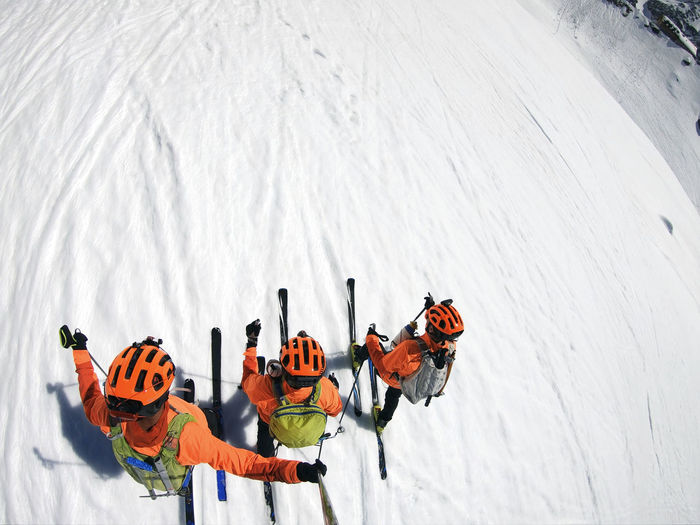 High angle view of people on snow covered mountain