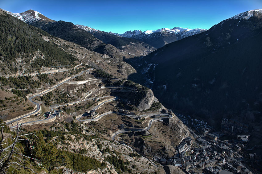 Mountain road in Andorra Mountain Mountain Range Environment Sunlight Physical Geography Outdoors Clear Sky Mountain Road Landscape Mountain Peak Pyrenees Snowy Peaks Snowcapped Mountain Pyrenees Mountains