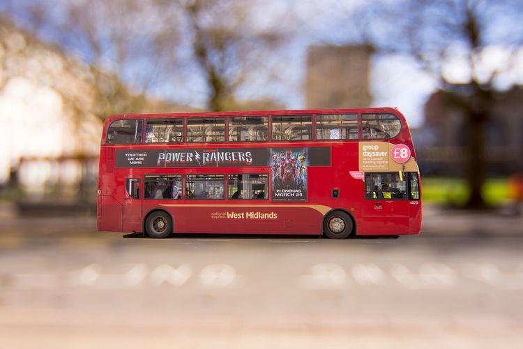 Birmingham bus in focus against blurred background Birmingham UK Blurred Background Bus Compsition Going Home Sunlight