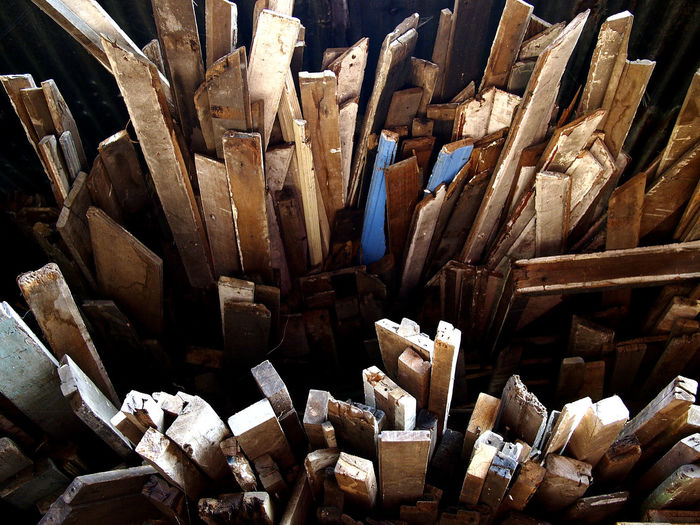 used and scrap planks of wood at a junk or scrap yard Reuse Recycling Recycle Recycled Materials Wood Plank Junkyard Scrapyard Texture Pattern Lumber Industry Stick Wood - Material Woodpile Timber Junkyard Scrap Metal Waste Management Firewood Lumber Industry Log Hardwood Garbage Dump Recycling Center Pile