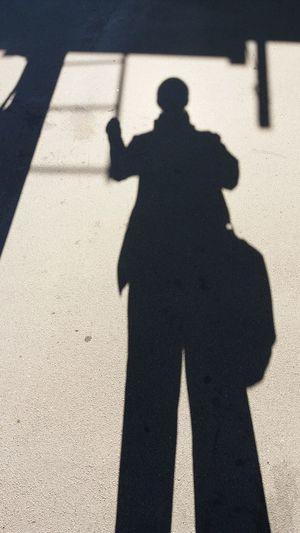 Shadow of man on footpath