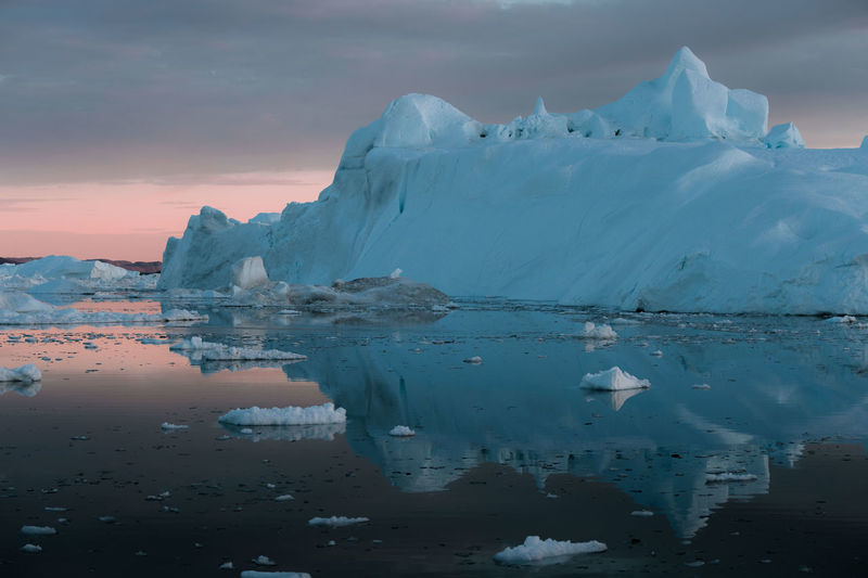 """Icebergs in a sunset depicting the color pantone of the year """"living coral"""" Cold Temperature Water Winter Ice Sky Beauty In Nature Frozen Snow Tranquil Scene Scenics - Nature Tranquility Glacier Reflection Environment Nature Sunset Iceberg - Ice Formation Landscape No People Outdoors Iceberg Melting Lagoon"""