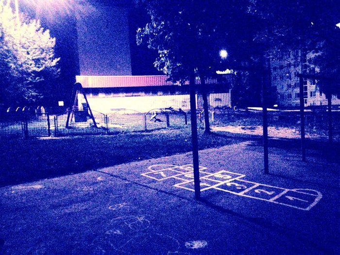 Children Playground Under Nightshade Children Playground Night Nightshade Undr EyeEmNewHere Blue Communication Text Outdoor Play Equipment Schoolyard