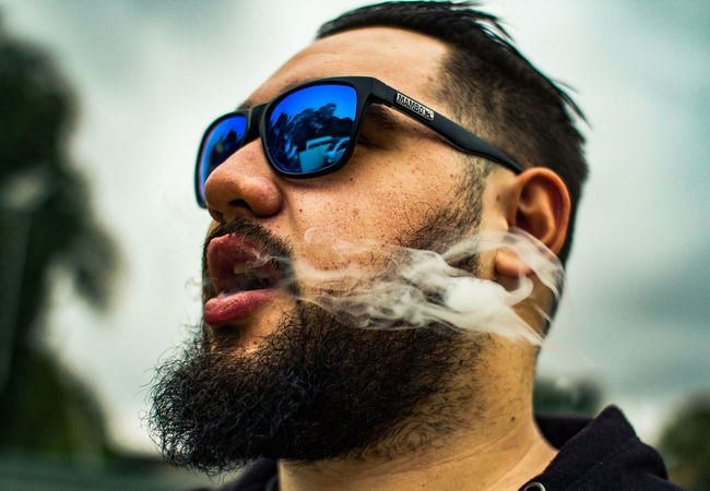 Chris Canon 7D Friends Smoke Smoking Beard Canon Close-up Facial Hair Fashion Glasses Headshot Human Face Lifestyles Lightroom Mate Men Mustache One Person Outdoors Portrait Real People Sunglasses Young Adult This Is My Skin The Portraitist - 2018 EyeEm Awards