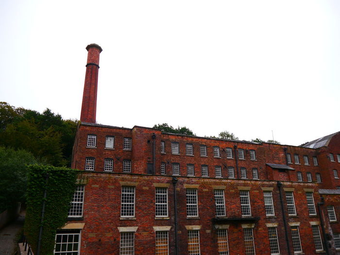 Quarry Bank Mill Building Exterior Built Structure Architecture Sky Clear Sky Building Low Angle View Industry Window No People Nature Day Copy Space Factory Smoke Stack Tree Outdoors Plant Brick History