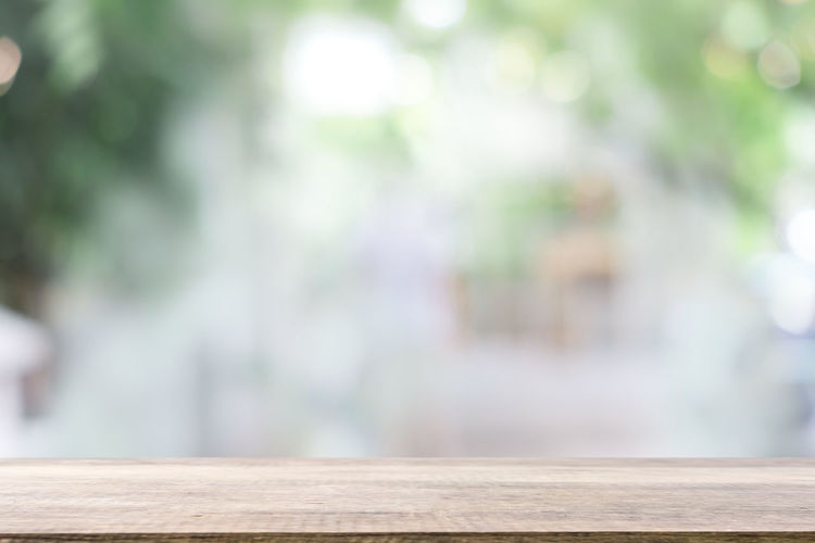 Close-up of wooden railing on table