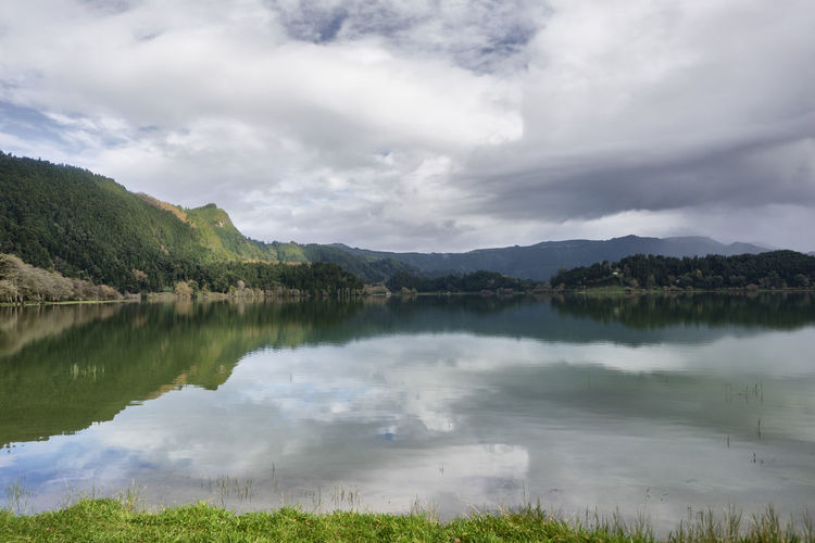 Water Sky Cloud - Sky Lake Tranquil Scene Tranquility Beauty In Nature Scenics - Nature Reflection Nature Mountain Day Non-urban Scene No People Idyllic Plant Outdoors Environment Landscape Reflection Lake Furnas Azores