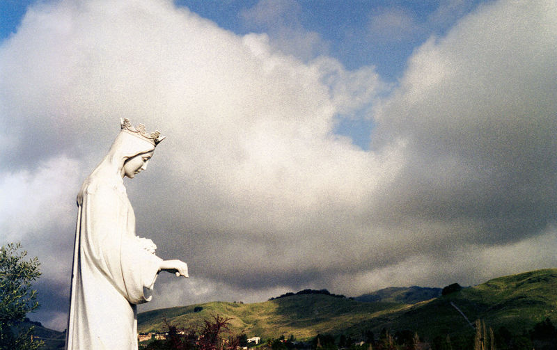 Statue Isabella  Saint Saint Isabella Catholic Catholicism Catholic Church San Rafael California Marin Marin County Church Hills Mountains Clouds Sky Sunlight Cloud - Sky Sculpture Mountain Day Religion Spirituality Human Representation No People