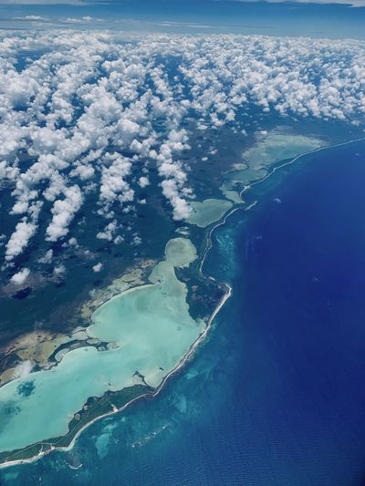 Aerial view of island amidst sea against sky