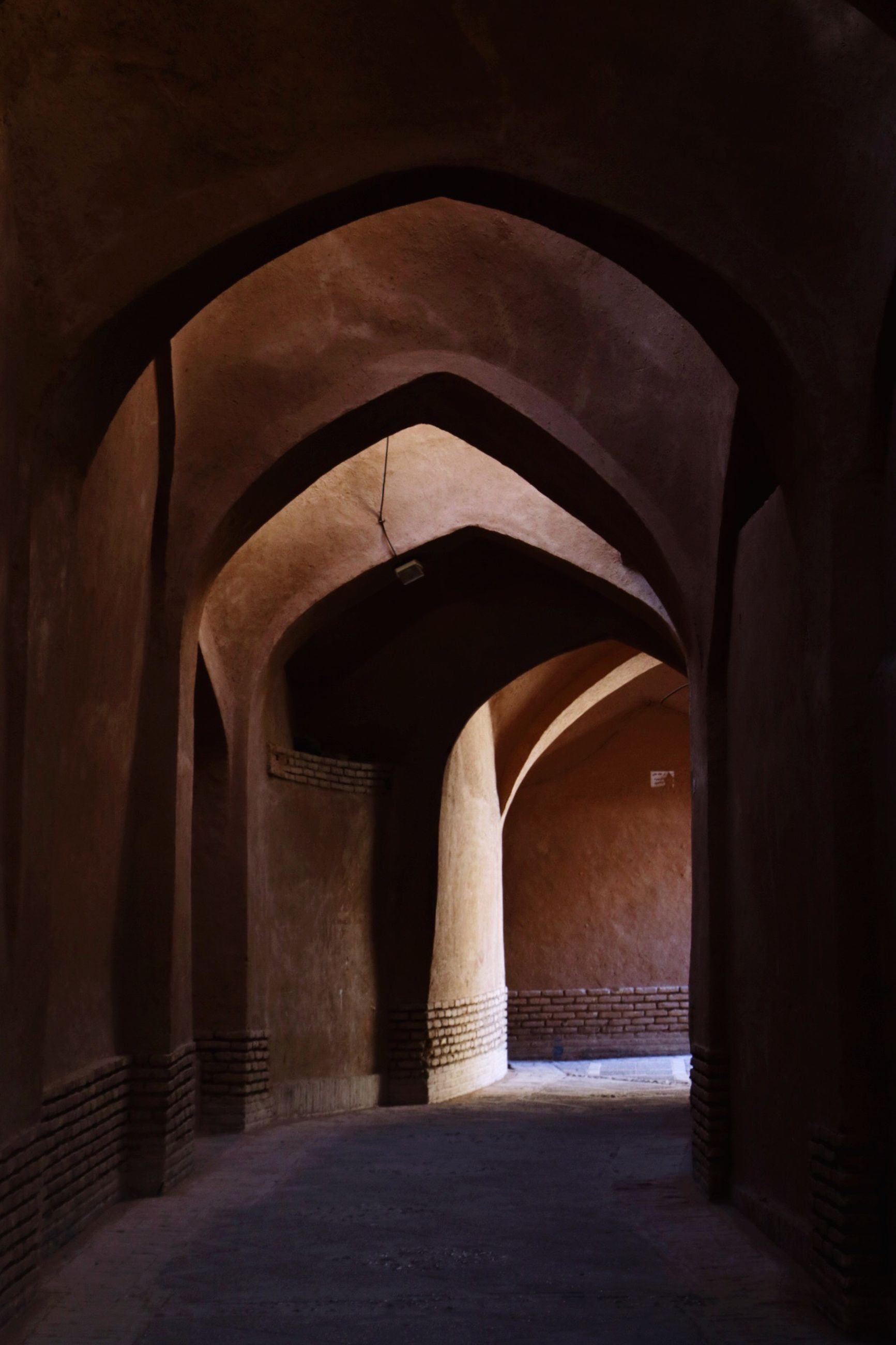 arch, indoors, history, architecture, travel destinations, architectural column, built structure, archway, no people, day, illuminated