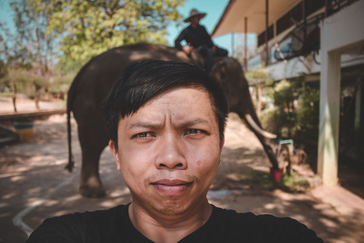 Selfie Portrait Headshot Real People One Person Looking At Camera Front View Lifestyles Focus On Foreground Close-up Leisure Activity Young Adult Young Men Tree Day Nature Men Outdoors Casual Clothing Human Face Hairstyle Contemplation ASIA Elephant Thailand Selfie